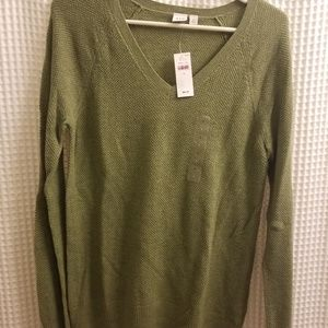 Green V-neck sweater